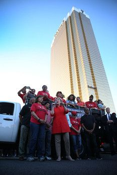 Democratic presidential candidate Hillary Clinton (C) speaks to union members gathered in front of the Trump International Hotel & Tower Las Vegas named and founded by the leading Republican presidential candidate Donald Trump on Oct. 12 in Las Vegas.