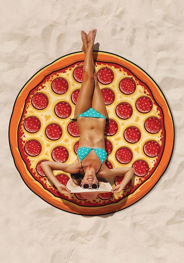 Pizza first Pizza always first, because even if you're laying out somewhere sandy, you know pizza will always be in your heart. Lay face down on this so you can keep your heart literally next to all the cheesy goodness of this towel. This giant round pizza towel is also about the same prize as an actual large pie in NYC, $24.95, so all signs seem to be pointing to 'buy it.' Available at Love Culture.com!