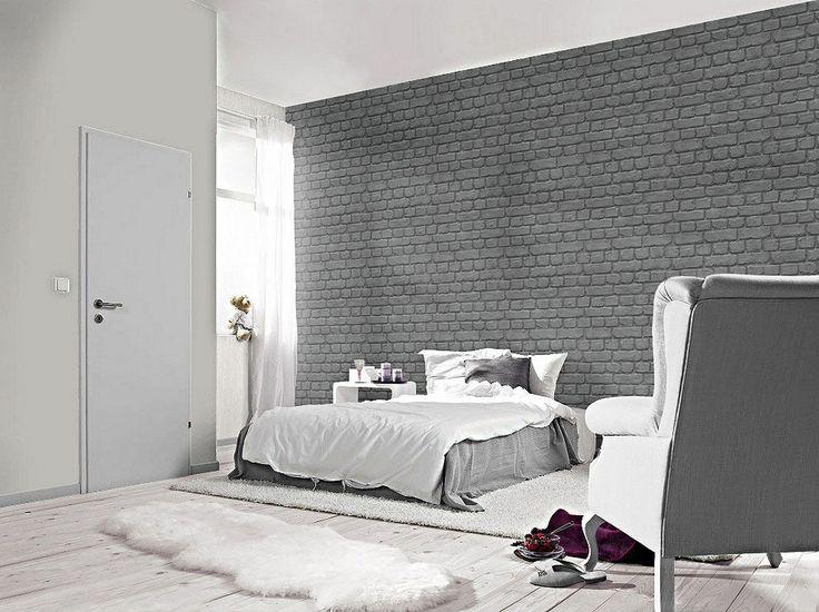 El estilo industrial cada vez tiene más peso en el interiorismo. Consigue un dormitorio de lo más actual con este papel pintado de ladrillo gris.