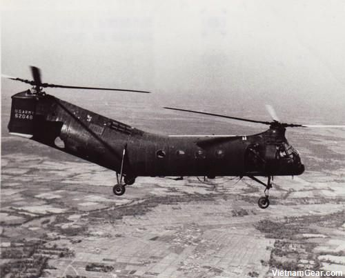 "Vietnam War - A CH-21 Shawnee (""Flying Banana"") Helicopter from the 57th Helicopter Company flies over a Viet Cong area during a routine mission.    Photo taken: 1st February 1963"