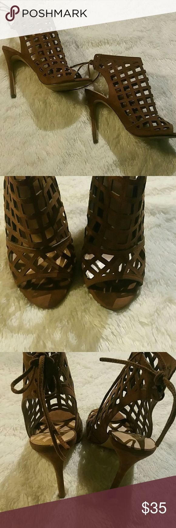 """Ultra Chic Caged heels by Express Faux suede heels by Express. Only worn once. Excellent pre owned condition. Lace up back, gorgeous caged look. 5"""" heel no signs of wear, heel tips are intact. No box.  Accepting reasonable offers. Express Shoes Heels"""
