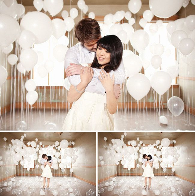 An engagement photo session with a room filled with balloons.