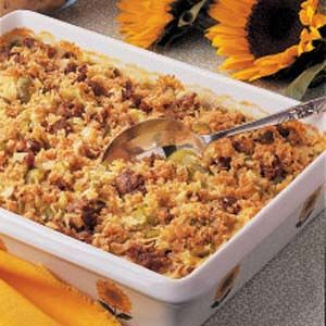 Baked Rice with Sausage Recipe -This recipe is perfect for potlucks or church suppers since it produces a big batch and has flavors with broad appeal. Most folks can't guess that the secret ingredient is chicken noodle soup mix. -Naomi Flood, Emporia, Kansas