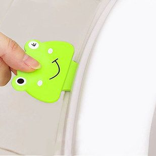 A frog-shaped toilet seat lifter - never touch a grimy lid again.