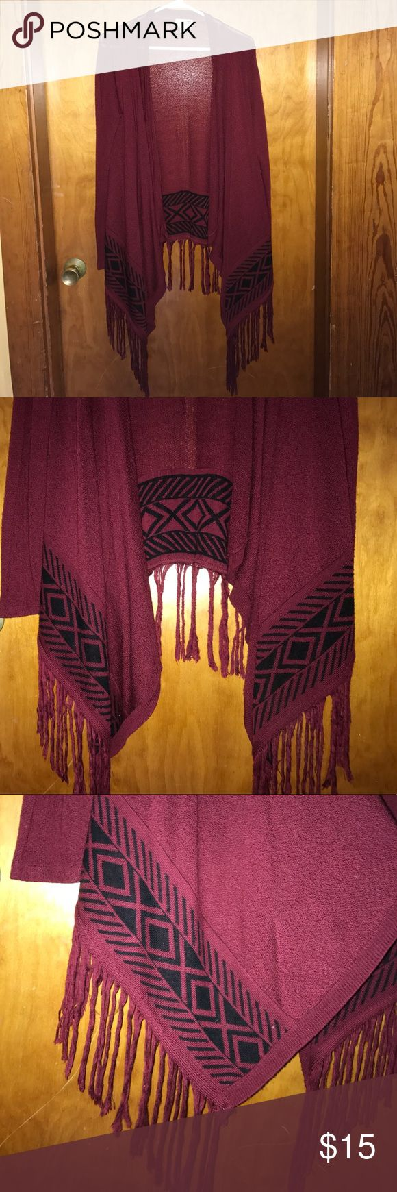 LA HEARTS burgundy tribal print fringe cardigan LA Hearts. Long sleeve burgundy cardigan with black tribal print at hemline. Burgundy fringe alone bottom. Longer in front and shorter in back. Worn once. LA Hearts Sweaters Cardigans
