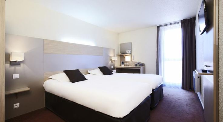 Kyriad Montélimar Centre Montélimar Located in the centre of Montelimar, the Kyriad Hotel provides modern rooms, free security parking and free Wi-Fi. It is a quiet setting, very close to entertainment, restaurants and shops.