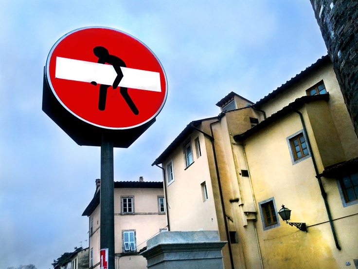 Modified road sign by Clet Abraham (https://www.facebook.com/pages/CLET/108974755823172) in Lucca, Italy.