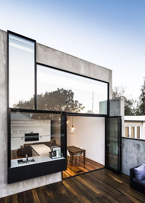 Great contrast with use of black metal windows, concrete, and mahogany (?) deck. Architect unknown.