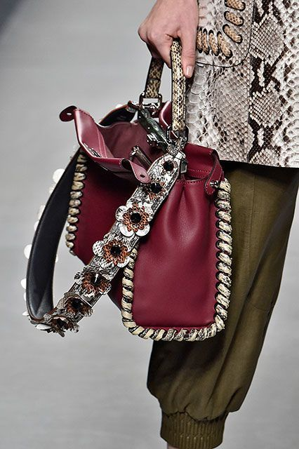 A muted palette, but still lots going on between the snakeskin handle, the weaving, and the floral strap. #refinery29 http://www.refinery29.com/2015/09/94671/fendi-bag-straps-spring-16#slide-3