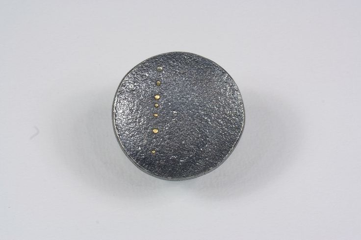 Sterling silver ring with gray black patina and pure gold details.
