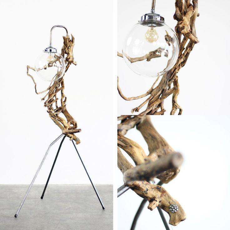 """Relaxed  Gedragen door en opgehangen aan oude elektriciteitsbuizen wordt de glazen bol met een dimbare Kooldraadlamp """"relaxed"""" omarmd door een klimop-tak van Landgoed Twickel nabij Delden. www.pietbrummelbos.nl"""