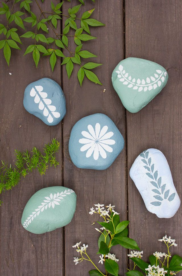 Painted pebbles tossed among your yard's natural elements offer an unexpected touch.