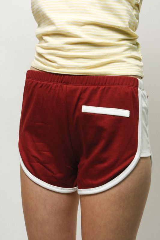 For gettin' cheeky at the roller rink, car wash, or just on your day off. French terry shorts with high cut sides. Elastic waistband. Faux pockets on front and back. Fits true to size. - White binding
