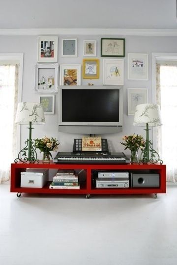 love the pics around tv wall mount and the idea of lamps. Don't like the red console - or those lamps, but like the overall look of it all.