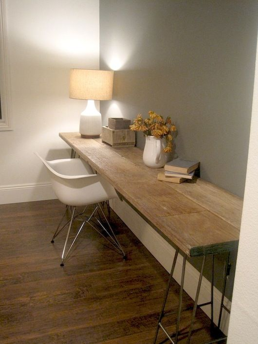 DIY rustic wood desk mounted on wall.