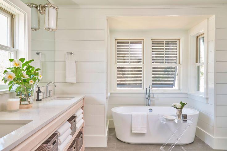 A soaking tub and shiplap walls make for a spa-like master bath, perfect for a beach house.
