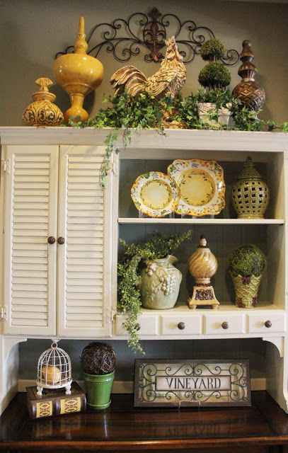 It looks like this is a light gray with white shutter doors and stained wood top... nice kind of a sophisticated combination....Savvy Seasons by Liz: Kitchen Accessorizing