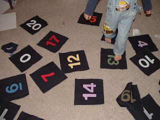 Pieces by Polly: Active Math Games and AWESOME Book | This would be a great way to teach number recognition by playing something similar to twister.