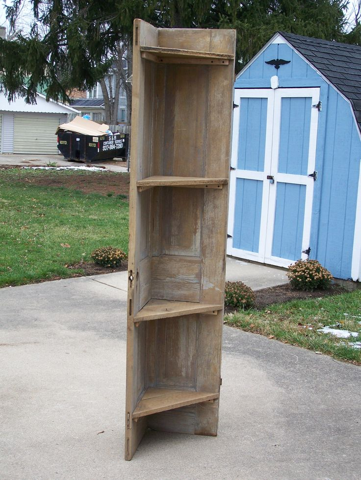 Cournershelf from an old door. The shelves are from old barn siding