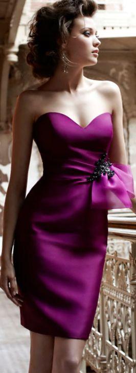 Eye-catching Fuschia cocktail dress worn by a glamorous young woman....
