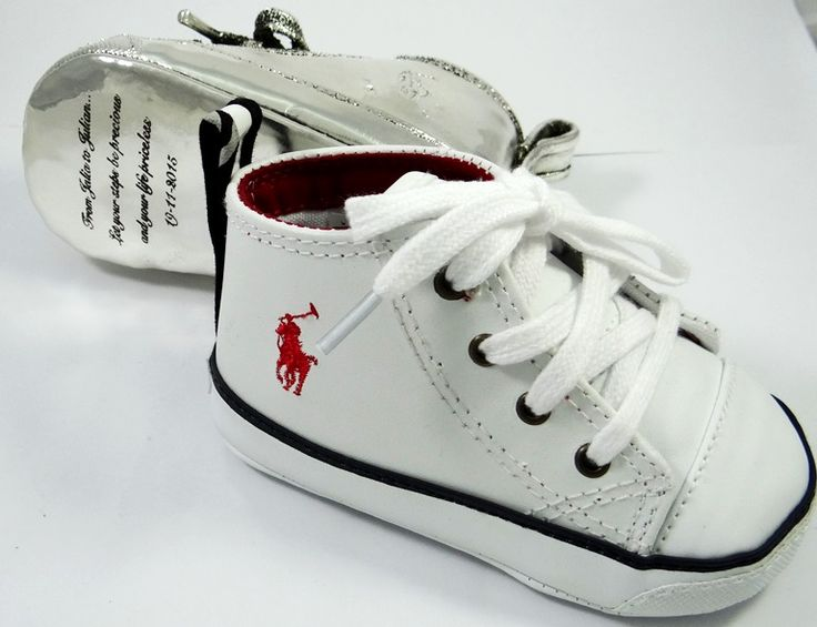 """Decorating shoes is an incredible art! This white tiny shoe after we """"put on"""" their new """"coat"""" silver metal. Your baby's first shoe...by Shine4ever.gr!"""