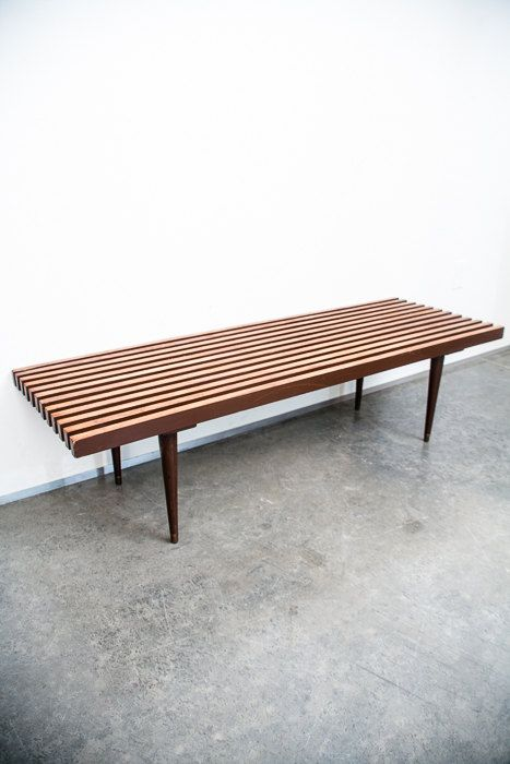 Mid century modern slat bench up for grabs. This minimalist thin lined piece is a style staple of the mid century modern period. Our bench
