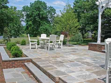 find out what a two level bluestone patio costs and how you can cut down but