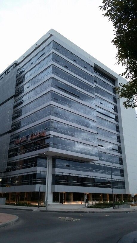 Colpatria unitized curtain wall.  Reynobond eco clean composite.  Sun screen metal multi drilled panel