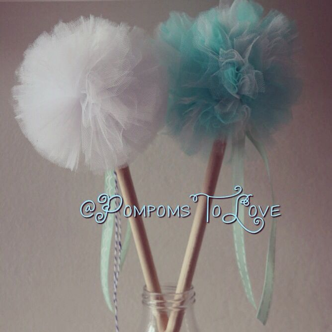 Planning a Frozen themed party? Pompom wands are the answer.