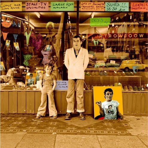 All New Boots and Panties, the iconic Ian Dury album cover silkscreen, showing Dury leaning against a shop front window with his son. Colours are yellow, black, white, green and orange. Signed limited edition silkscreen print by Sir Peter Blake. 26 colours. Silkscreen. Created, signed and editioned by Sir Peter Blake and the original photographer Chris Gabrin.