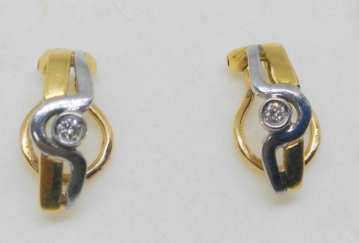 18 kt-witte en gele oorbellen met 2 diamanten  18 kt goud.Gewicht 37 gLengte: 16 mm2 briljant geslepen diamanten ca. 010 ct in totaal.Kleur: G.Duidelijkheid VS1Geregistreerde scheepvaart.GloednieuweOpslaan van ref.: mr3430345  EUR 20.00  Meer informatie
