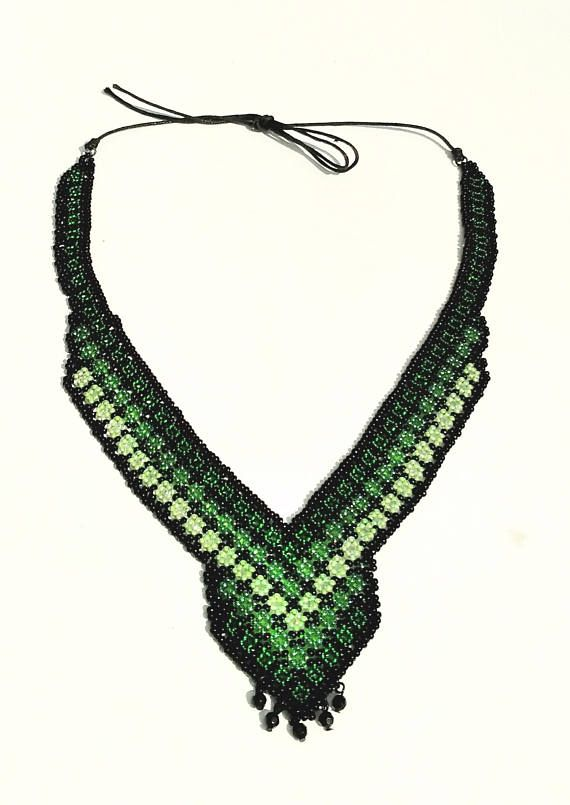 This beautiful beaded bib necklace in huicho style features a mix of sequential green colors and small pendulous pearls in the lower center. - Creatured for use on all occasions; At the office, a night or just hanging out. Combine this piece with your other favorite jewelery. - Try a