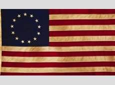 This picture represents the first American flag, said to have been sewed by Betsy Ross. The stars and the stripes on the original flag signify the 13 colonies that were united by the Declaration of Independence.
