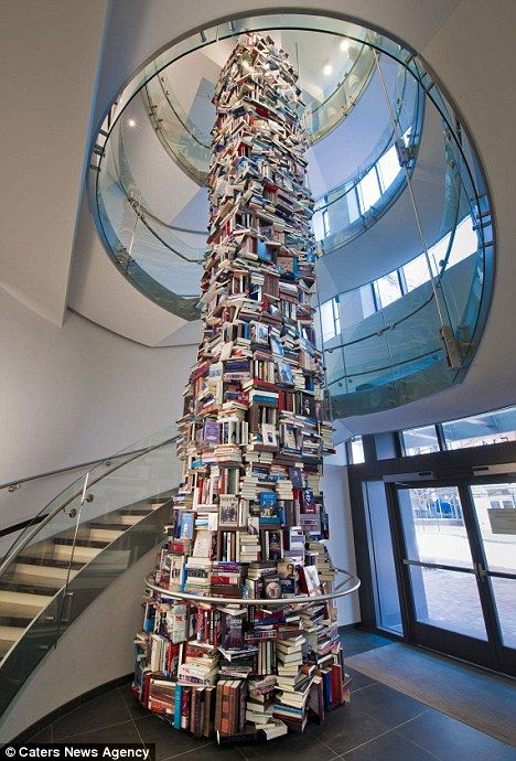 A 35ft-high tower of 15,000 books about Abraham Lincoln has been built on the spot in which he was assassinated