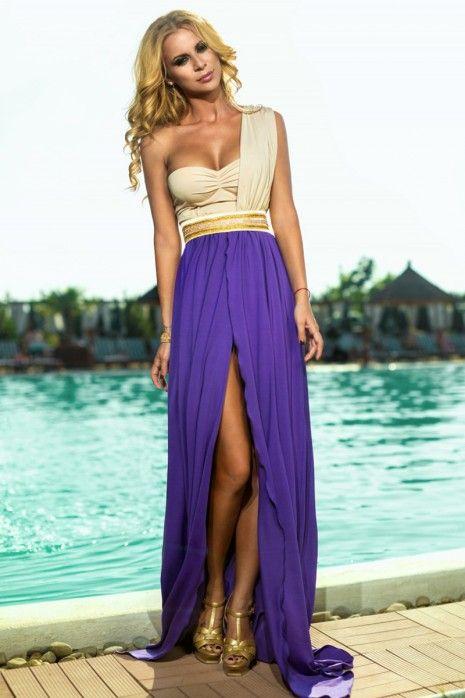 Rochie Desiree Violet - Rochie lunga, din licra bej in partea superioara si violet in partea inferioara este perfecta pentru evenimente deosebite la care esti invitata. Materialul din licra, bustul buretat, despicatura din fata precum si accesoriul tip strass din talie vor face din aparitia ta, una de diva. Se poate comanda online de aici…