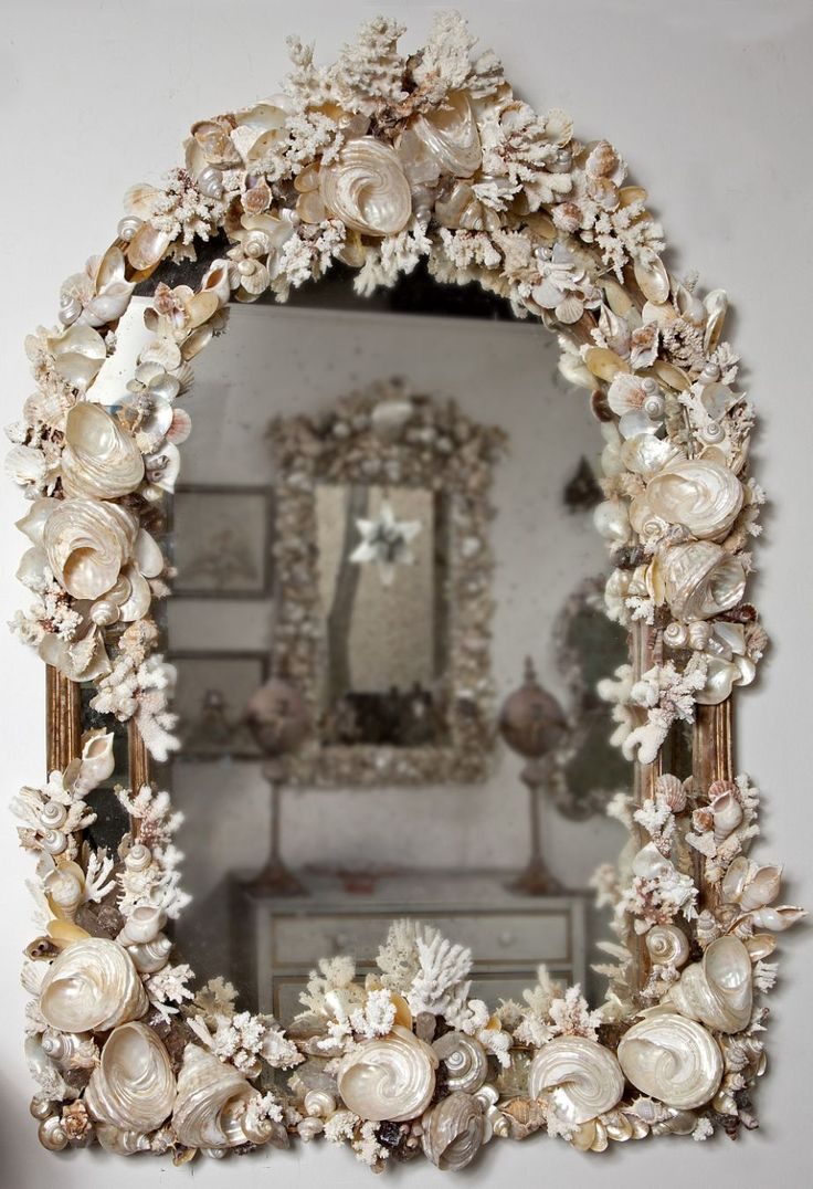 Coral and Shell Mirror.. I love this and might pay as much as $500.00?? for it but the cleanabiliety factor . It would look so much better on a darker wall which I've had in the past. Sq. would be a good shape also,