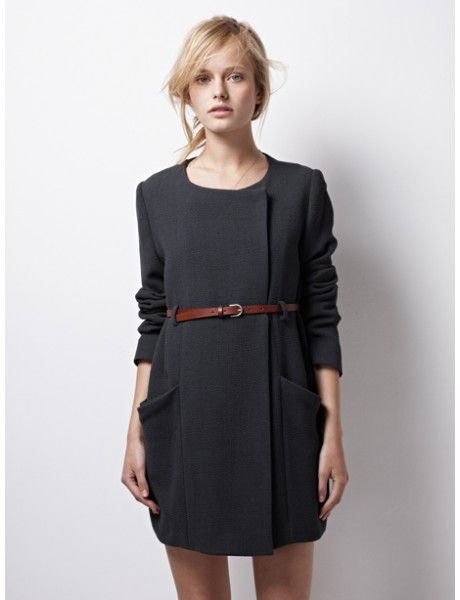 Short black belted dress with pockets.