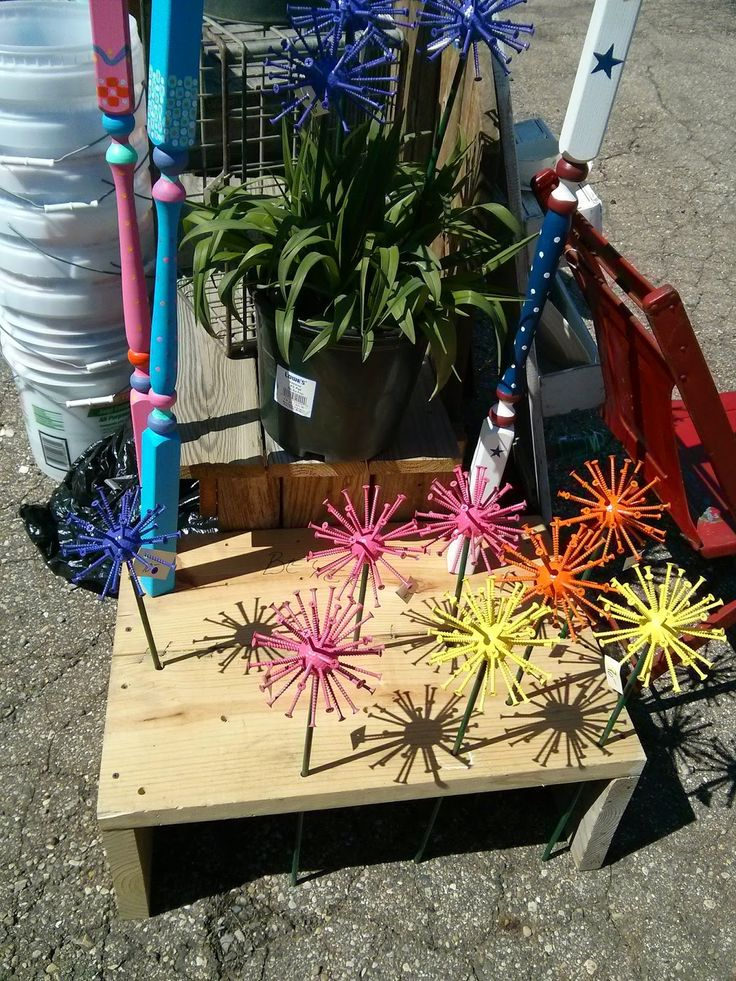 Golf balls with nails or screws then painted bright colors.  Looks like flowers in your flower beds.  Bargain Hunting Treasure Seeker