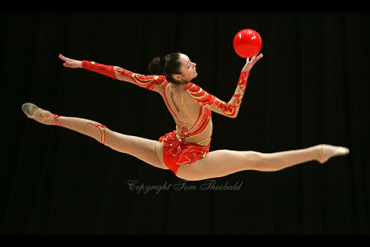 Anna Bessonova of Ukraine (here split leap to recatch ball) wins Gold, Silver and Bronze in rhythmic gymnastics apparatus finals at World Games from Duisburg, Germany on July 20-21, 2005.  Event finals in rhythmic gymnastics are only held at World Games. (Photo by Tom Theobald)
