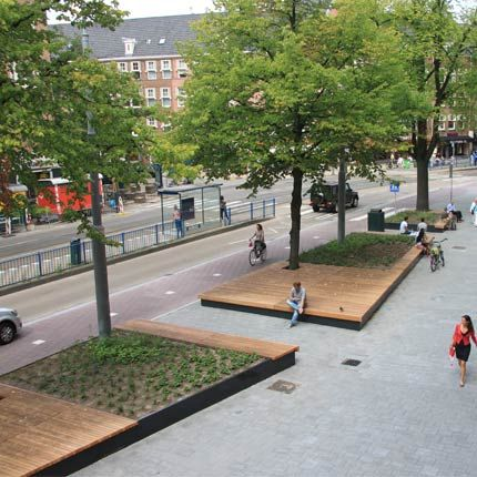 urban podium with large hardwood seating area and greenery. StreetLife