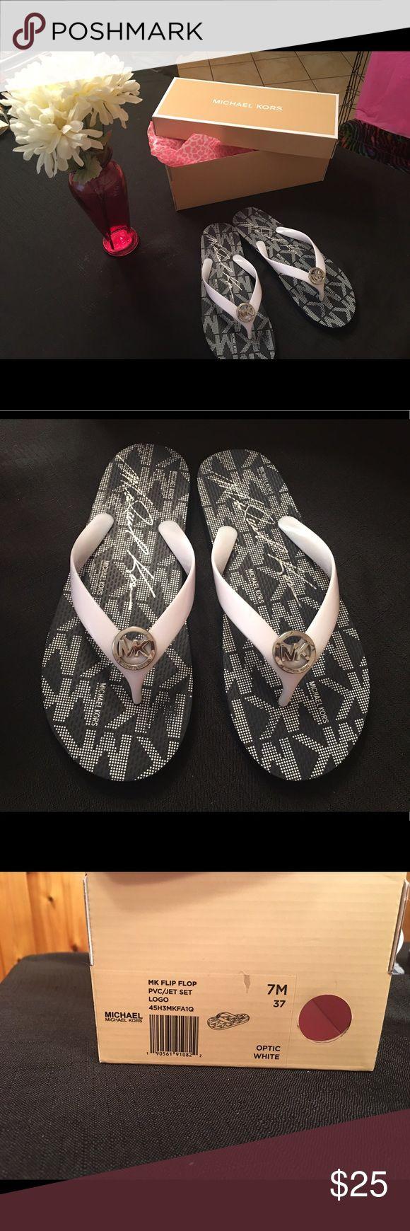 Michael kit flip flops size 7m Super cute navy blue and white flip flops , gently used, 7m .. Michael Kors Shoes Sandals