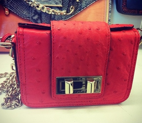 """""""The perfect little red bag by Rebecca Minkoff"""" (glamour mag)."""