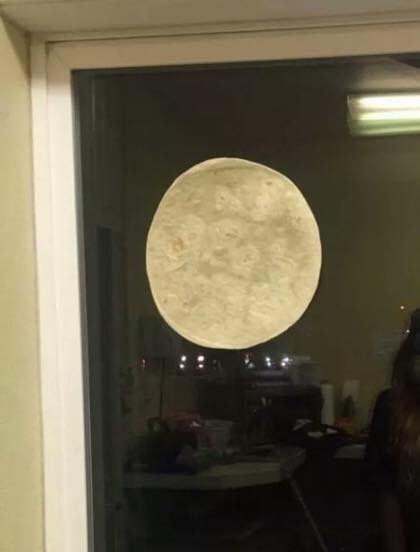 Can't see the super moon tonight!  Too cloudy, simply tape a tortilla to your window!