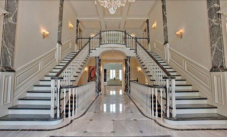 Regina George's Mean Girls Mansion Is For Sale For $14.8M - The two-story entrance is filled with Italian marble.