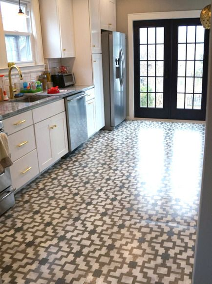 WOW!! painted concrete kitchen floors  found at: Little Green Notebook: Reader DIY: Stenciled Kitchen Floors - and eco friendly. // Hmmmm. DIY? Yikes!!!!