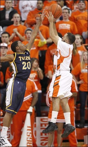 University of Toledo player Julius Brown, 20, defends as Bowling Green State University Jordan Crawford, 1, puts up a shot during the first half at the Stroh Center at Bowling Green State University, Saturday.  2/12/2012   THE BLADE/ANDY MORRISON