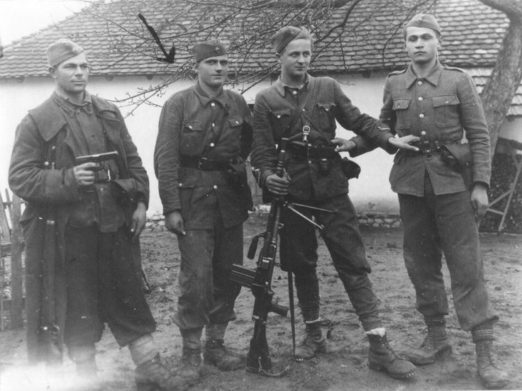 Four soldiers of the 6th Brigade of the People's ...