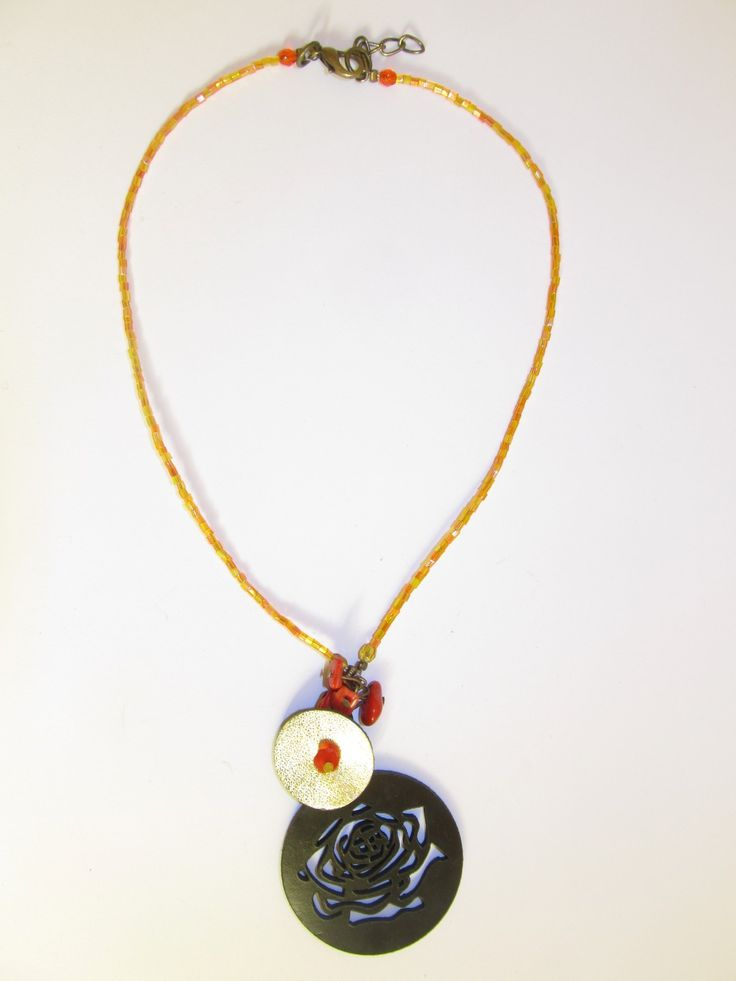 Handmade short leather necklace (1 pc)  Made with black leather filigree, gold leather part, corals and glass beads.