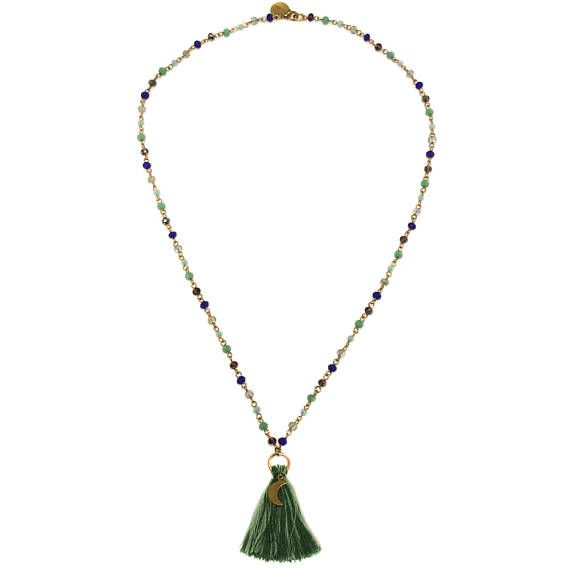 Vibrant and dramatic this necklace is based around peacock plumage. A handmade mini glass rosary chain in a mix of jade green, indigo blue, turquoise and shimmering titanium periwinkle ends in a handmade cotton tassel pendant in two tones of green finished with a brass moon charm. Each side measures approx. 28cm and the tassel is approx. 5cm in length. Lobster clasp closure and hand stamped tag.