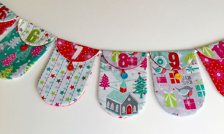 Free pattern for Advent Bunting. Each pennant is a pocket in which to put an Advent gift. Handmade Advent calendar www.mackandmabel.blogspot.co.uk